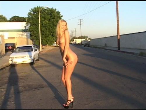 Girl walks down the street naked