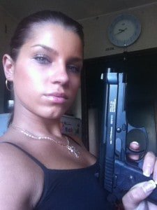 Angel Rivas Holding a Gun