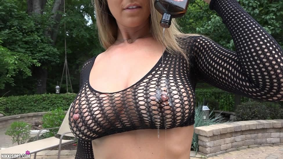 Nikki Sims is a gorgeous solo model with big natural tits and a tight curvy  body. Nikki is a queen of tease with plenty of accidental explicit slips.